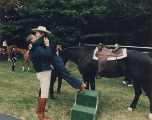 ronald reagan helps wife nancy off horse