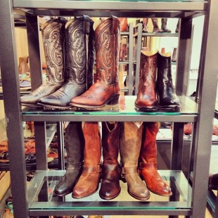 Frye cowboy boots on display