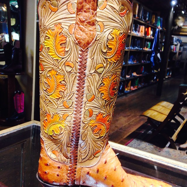 carved and painted cowboy boots