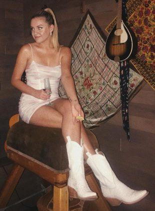 Kelsea Ballerini cute in white cowboy boots